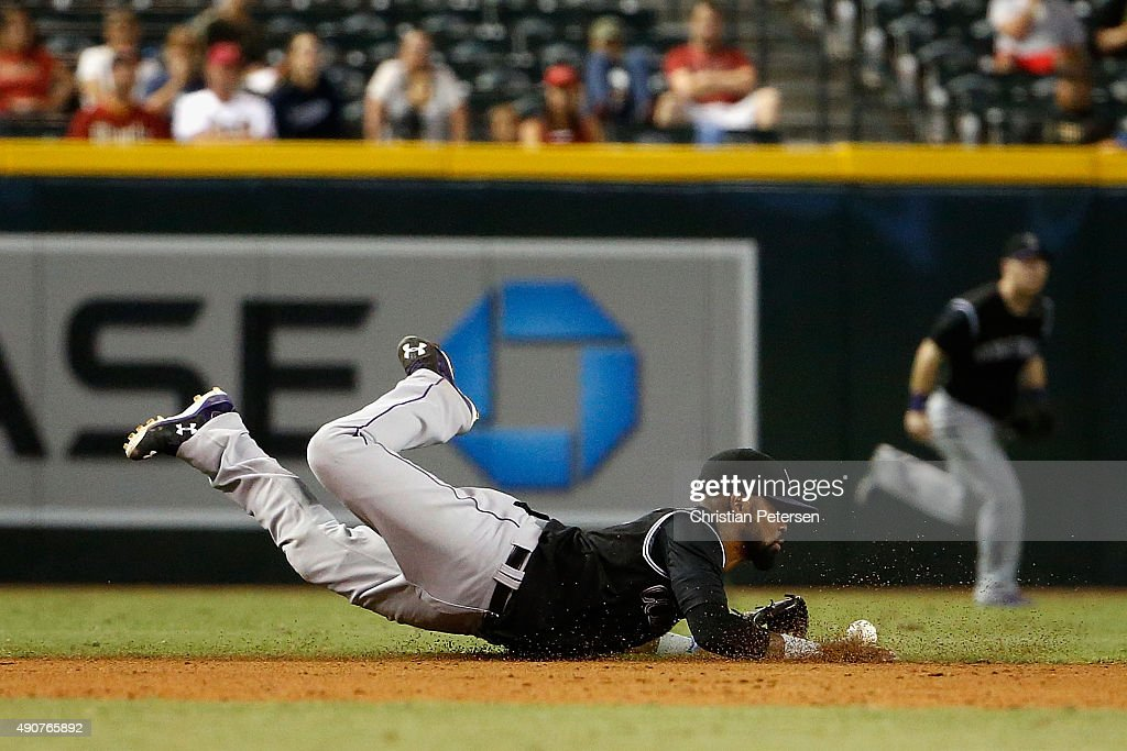 Infielder Jose Reyes #7 of the Colorado Rockies dives for a single hit by Jamie Romak (not pictured) of the Arizona Diamondbacks during the eight inning of the MLB game at Chase Field on September 30, 2015 in Phoenix, Arizona. The Diamondbacks defeated the Rockies 3-1.