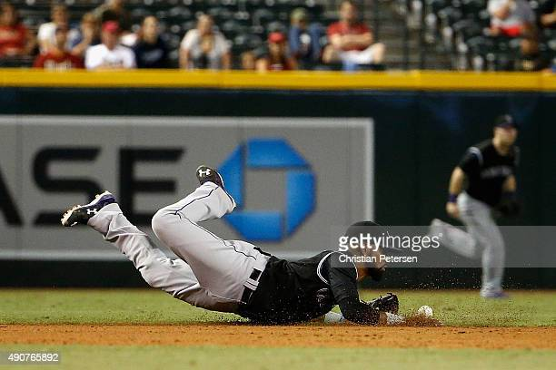 Infielder Jose Reyes of the Colorado Rockies dives for a single hit by Jamie Romak of the Arizona Diamondbacks during the eight inning of the MLB...