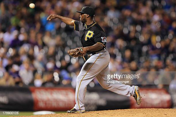 Infielder Josh Harrison of the Pittsburgh Pirates takes the mound to pitch against pinch hitter Corey Dickerson of the Colorado Rockies in the eighth...