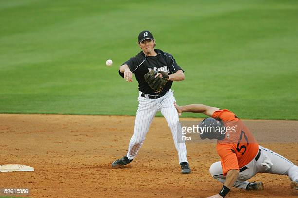 Infielder Josh Wilson of the Florida Marlins tries to convert a double play against the Baltimore Orioles during a spring training game on March 3...