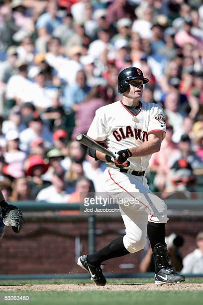 Infielder JT Snow of the San Francisco Giants bats during the game against the Los Angeles Dodgers at SBC Park on September 25 2004 in San Francisco...
