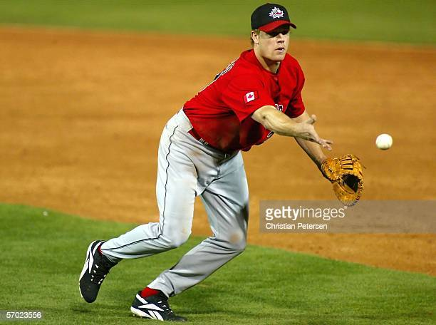 Infielder Justin Morneau of Team Canada flips the ball to first base for the out against Team South Africa during the Round 1 Pool B Game of the...