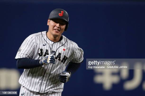 Infielder Kazuma Okamoto of Japan celebrates hitting a solo homer to make it 2-1 in the bottom of 2nd inning during the game five between Japan and...