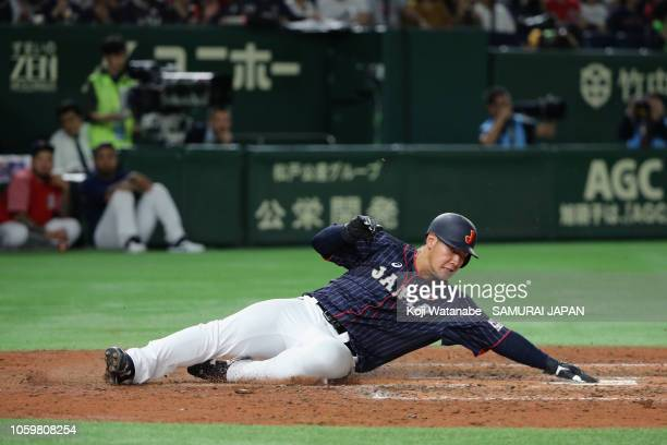 Infielder Kazuma Okamoto of Japan slides safely to score a run by a two-rin single by Outfielder Shogo Akiyama of Japan in the top of 5th inning...