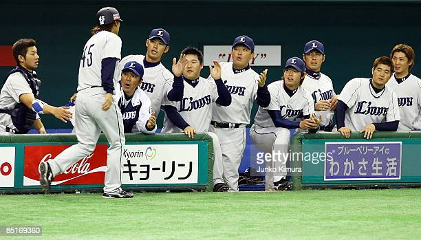 Infielder Keisuke Mizuta of Saitama Seibu Lions celebrates after scoring during a friendly match between South Korea and Saitama Seibu Lions at Tokyo...