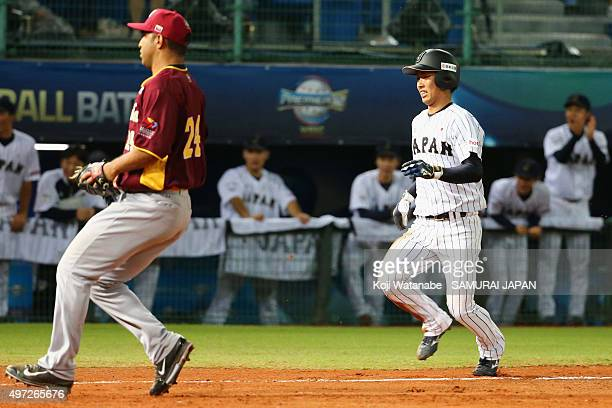 Infielder Kenta Imamiya of Japan runs to score to make 5-5 by a wild pitch by Fernando Alexis Nieve Flores of Venezuela in the bottom of ninth inning...