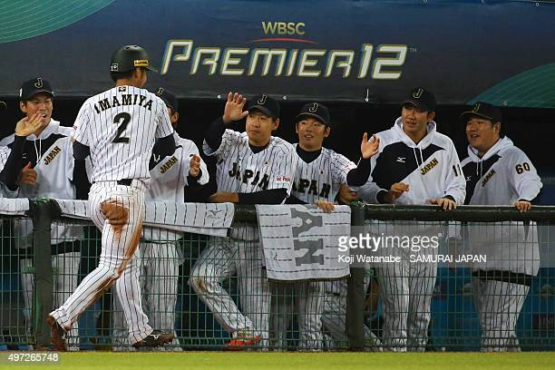 Infielder Kenta Imamiya of Japan celebartes with his team mates after scoring to make 5-5 by a wild pitch by Fernando Alexis Nieve Flores of...
