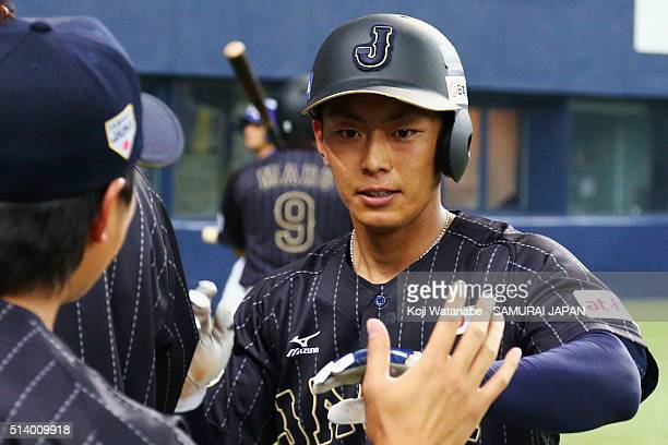 Infielder Kenta Imamiya of Japan celebrates with his team mates after scoring to make 2-1 in the top of fifth inning during the international...