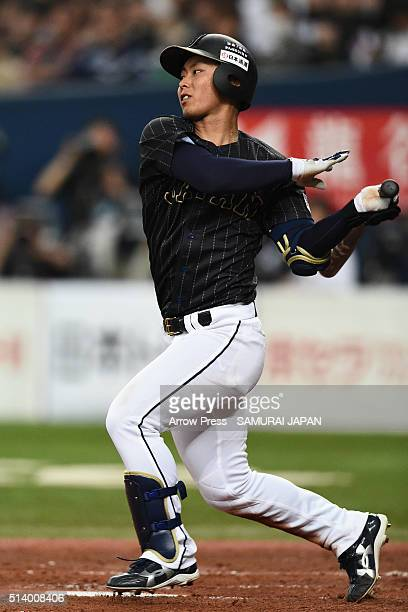 Infielder Kenta Imamiya of Japan hits a single in the top of fifth inning during the international friendly match between Japan and Chinese Taipei at...