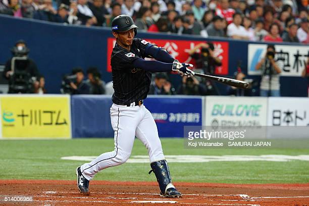 Infielder Kenta Imamiya of Japan hits a single in the top of third inning during the international friendly match between Japan and Chinese Taipei at...