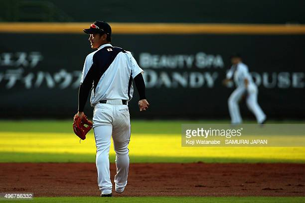Infielder Kenta Imamiya of Japan looks on during a warming up prior to the WBSC Premier 12 match between Japan and Dominican Republic at the Taoyuan...