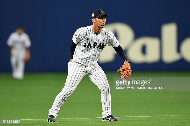 Infielder Kenta Imamiya of Japan prepares prior to the top of seventh inning during the international friendly match between Japan and Chinese Taipei...