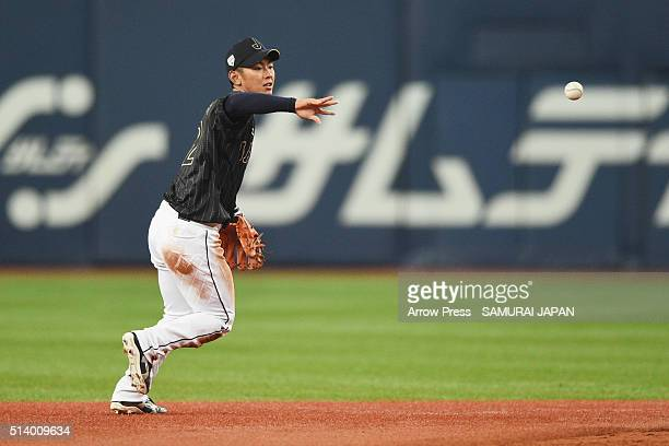 Infielder Kenta Imamiya of Japan tosses to the second base to make a double play in the bottom of fifth inning during the international friendly...