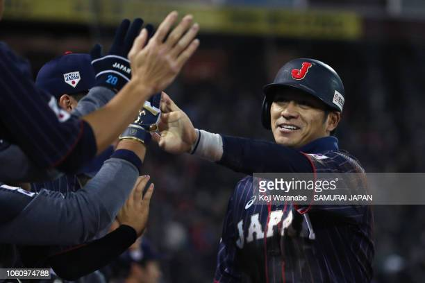 Infielder Kosuke Tanaka of Japan celebrates scoring a run to make it 43 by a squeeze bunt of Infielder Ryosuke Kikuchi in the top of 9th inning...