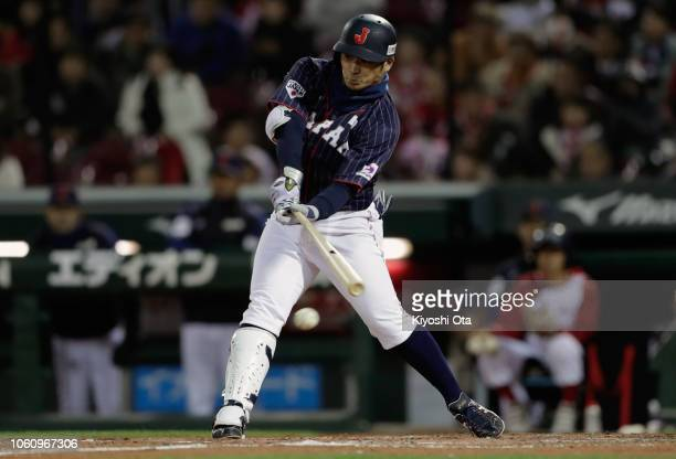 Infielder Kosuke Tanaka of Japan hits a RBI single to make it 33 in the top of 9th inning during the game four between Japan and MLB All Stars at...