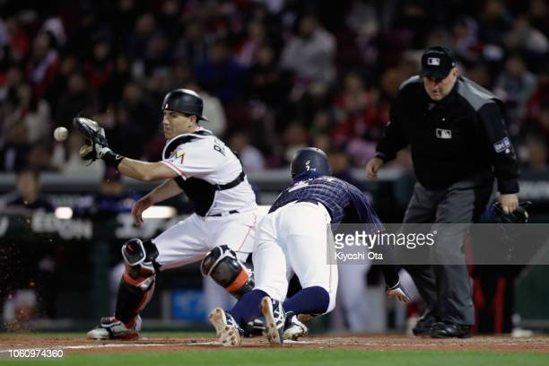 Infielder Kosuke Tanaka of Japan slides safely into the home base by a squeeze bunt by Infielder Ryosuke Kikuchi to make it 43 in the top of 9th...