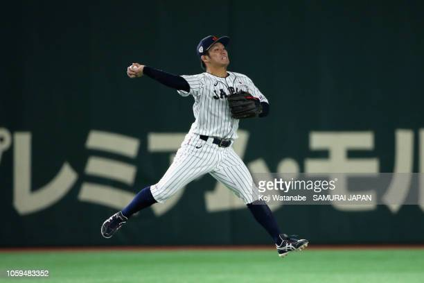 Infielder Kosuke Tanaka of Japan throws to the second base to force out int in the top of 2nd inning during the game one of the Japan and MLB All...