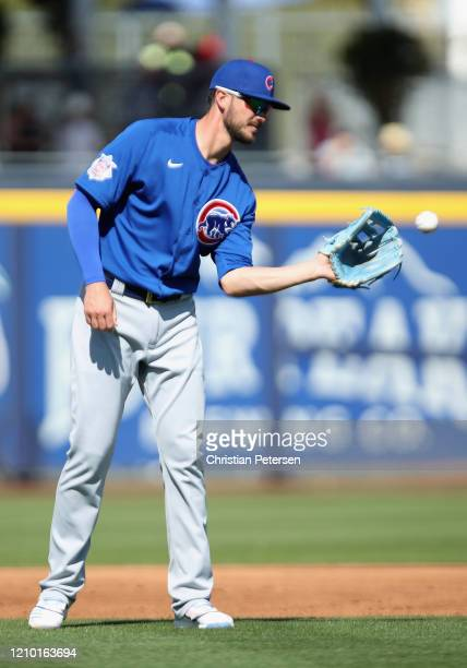 Infielder Kris Bryant of the Chicago Cubs warms up during the MLB spring training game against the Seattle Mariners at Peoria Stadium on February 24,...