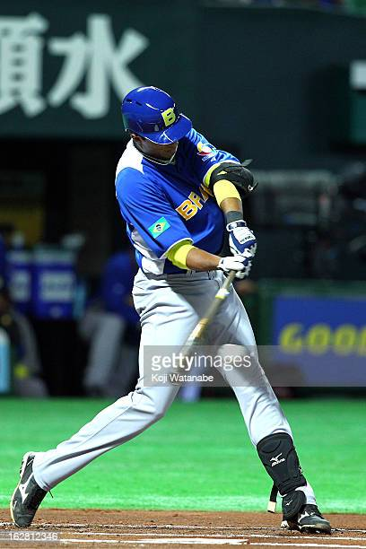 Infielder Leonardo Reginatto of Brazil hits a single in the top half of the first inning during the friendly game between Fukuoka Softbank Hawks and...