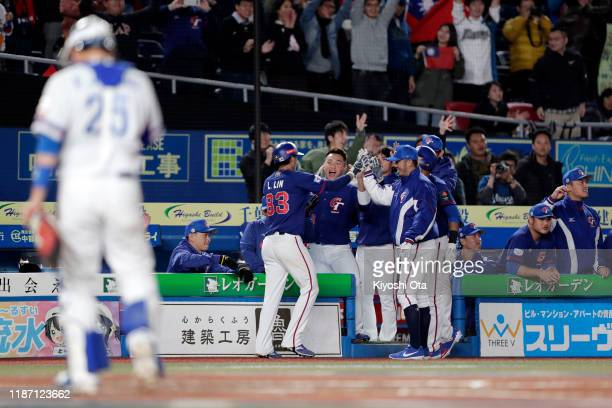 Infielder Lin Li of Chinese Taipei celebrates scoring a run by a RBI single of Infielder Wang Sheng-Wei in the top of 4th inning during the WBSC...