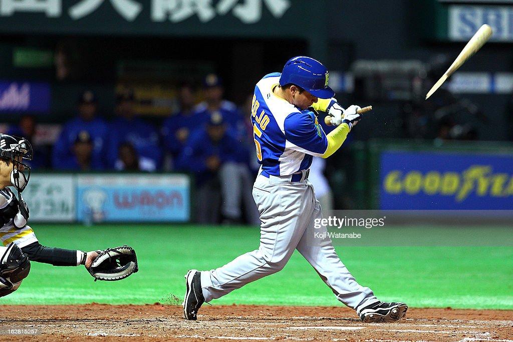 Infielder Lucas Rojo #15 snaps his bat as he hits out during the friendly game between Fukuoka Softbank Hawks and Brazil at Fukuoka Yafuoku! Dome on February 28, 2013 in Fukuoka, Japan.