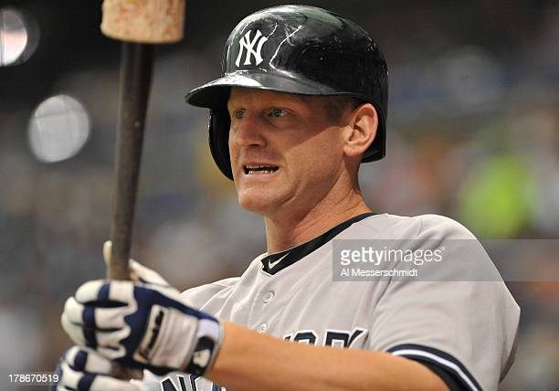 Infielder Lyle Overbay of the New York Yankees sets to bat against the Tampa Bay Rays August 25 2013 at Tropicana Field in St Petersburg Florida The...