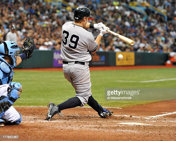 Infielder Mark Reynolds of the New York Yankees bats against the Tampa Bay Rays August 25 2013 at Tropicana Field in St Petersburg Florida The...