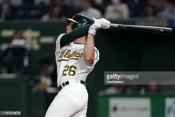 Infielder Matt Chapman of the Oakland Athletics hits a double in the 3rd inning during the game between Seattle Mariners and Oakland Athletics at...