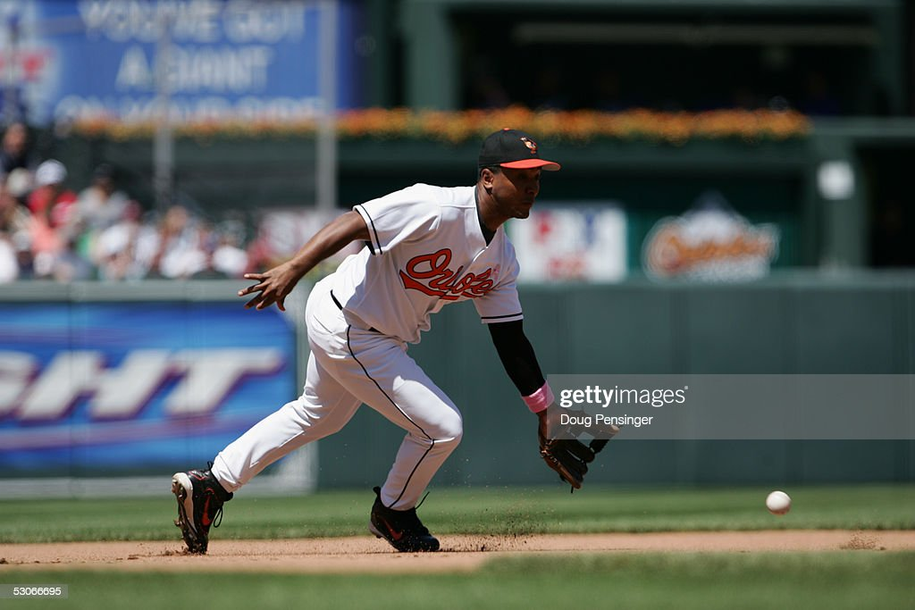 Infielder Melvin Mora #6 of the Baltimore Orioles attempts to make a catch against the Kansas City Royals during MLB action at Oriole Park at Camden Yards on May 8, 2005 in Baltimore, Maryland. The Royals defeated the Orioles 10-8.