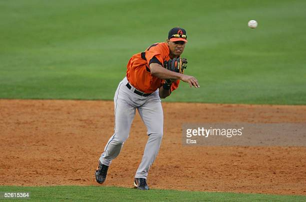 Infielder Melvin Mora of the Baltimore Orioles fields and throws a ball against the Florida Marlins during a spring training game on March 3 2005 at...