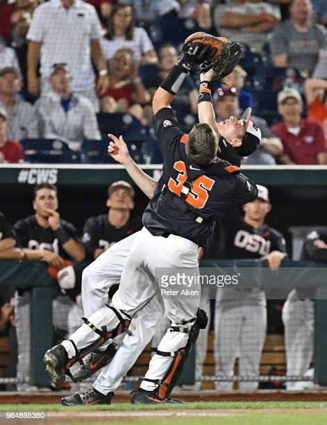 Infielder Michael Gretler of the Oregon State Beavers and catcher Adley Rutschman collide attempting to catch a foul ball in the ninth inning against...