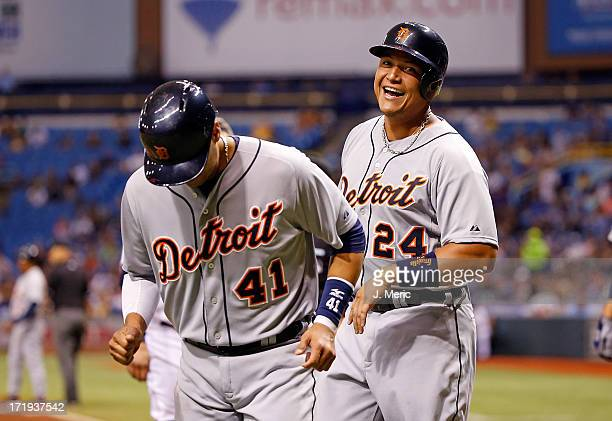 Infielder Miguel Cabrera of the Detroit Tigers smiles as he and Victor Martinez score in the third inning against the Tampa Bay Rays at Tropicana...