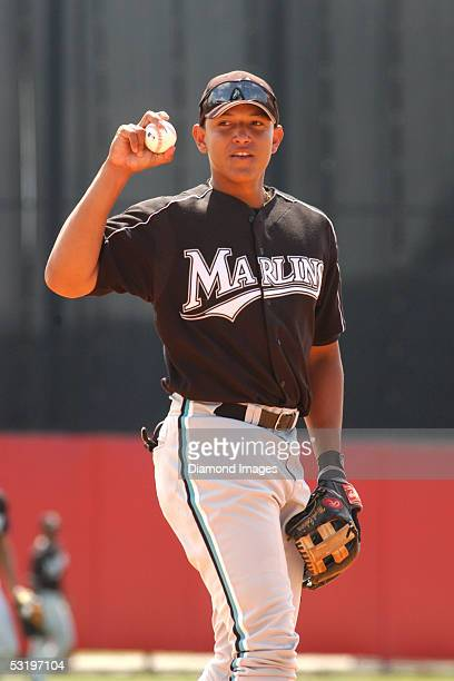 Infielder Miguel Cabrera of the Florida Marlins takes ground balls at thirdbase during batting practice prior to a Spring Training game on March 17...