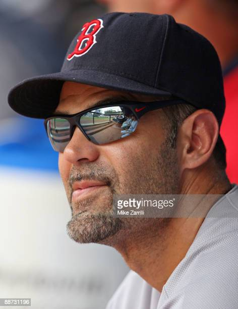Infielder Mike Lowell of the Boston Red Sox watches the scoreboard during the game against the Atlanta Braves at Turner Field on June 28 2009 in...