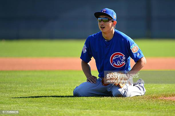 Infielder Munenori Kawasaki of the Chicago Cubs during infield drills at a spring training workout at Sloan Park on February 24 2016 in Mesa Arizona