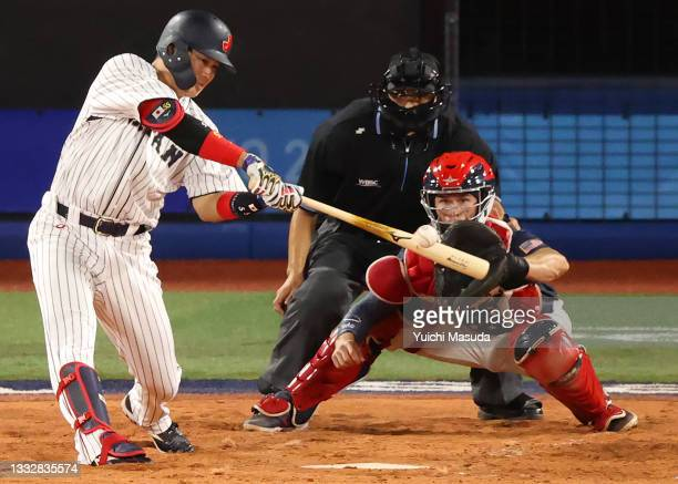 Infielder Munetaka Murakami of Team Japan hits a solo home run in the third inning against Team United States during the gold medal game between Team...