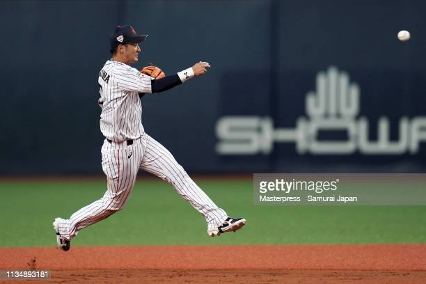 Infielder Naoki Yoshikawa of Japan throws in the top of 7th inning during the game two between Japan and Mexico at Kyocera Dome Osaka on March 10...