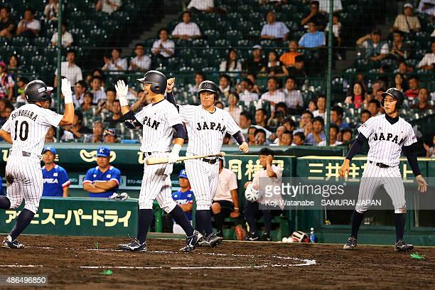 Infielder Naruki Sugisaki of Japan celerates after scoring in the bottom half of the fifth inning the game between Australia and Japan in the super...
