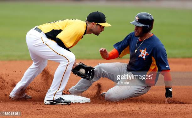 Infielder Neil Walker of the Pittsburgh Pirates tags out JD Martinez of the Houston Astros on a steal attempt during a Grapefruit League Spring...