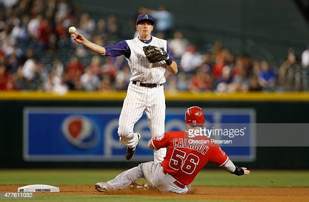 Infielder Nick Ahmed of the Arizona Diamondbacks throws over the sliding Kole Calhoun of the Los Angeles Angels to complete a double play during the...