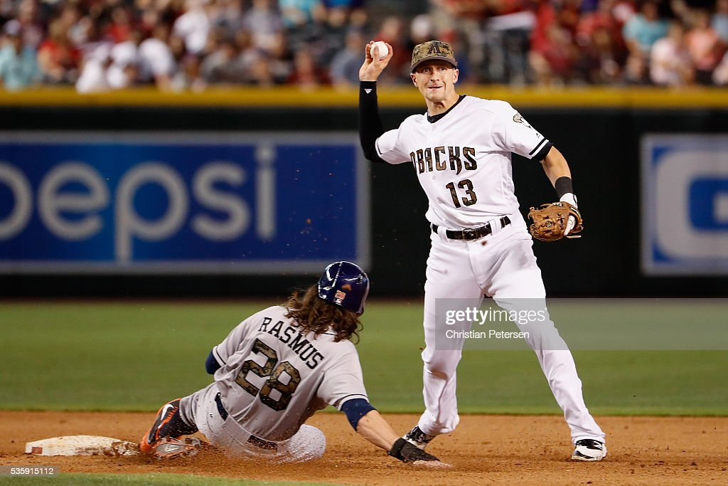 Infielder Nick Ahmed #13 of the Arizona Diamondbacks throws over the sliding Colby Rasmus #28 of the Houston Astros to complete a double play during the eighth inning of the MLB game at Chase Field on May 30, 2016 in Phoenix, Arizona.