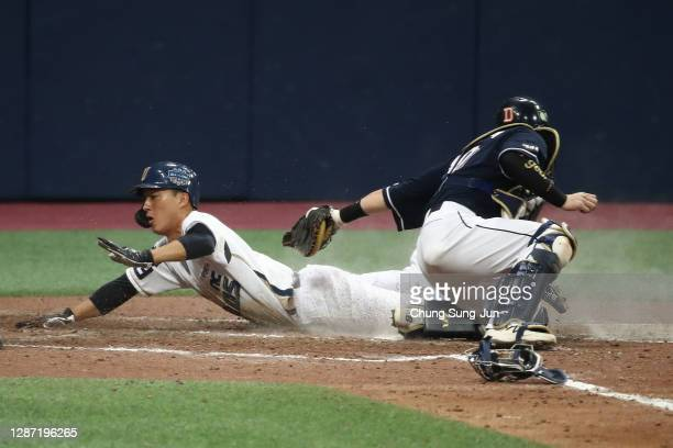 Infielder No Jin-Hyuk of NC Dinos slides home to score a run to make it 1-0 by the RBI double of Outfielder Aaron Altherr in the bottom of fifth...