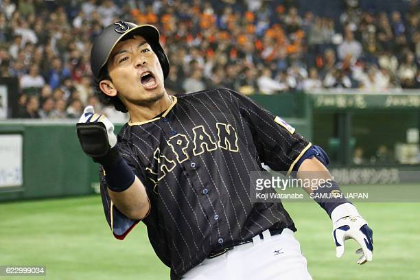 Infielder Nobuhiro Matsuda of Japan celebrates after hitting a solo homer in the fourth inning during the international friendly match between...