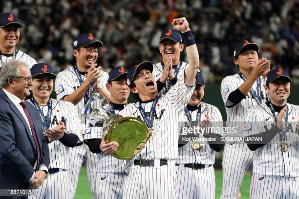 Infielder Nobuhiro Matsuda of Japan celebrates after receiving the WBSC Premier 12 trophy at the ceremony following the WBSC Premier 12 final game...