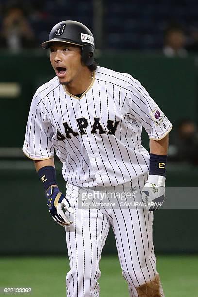 Infielder Nobuhiro Matsuda of Japan celebrates after scoring by a single of Outfielder Seiya Suzuki of Japan during the international friendly match...
