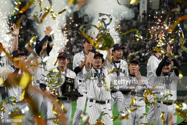 Infielder Nobuhiro Matsuda of Japan lifts the trophy during the ceremony after the WBSC Premier 12 final game between Japan and South Korea at the...