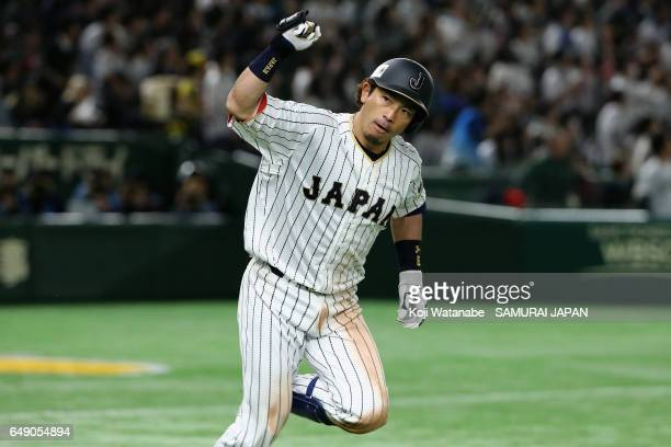 Infielder Nobuhiro Matsuda of Japan raises his fist after hitting a threerun homer in the bottom of the fifth inning during the World Baseball...