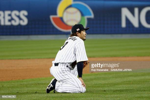 Infielder Nobuhiro Matsuda of Japan reacts after his fielding error allowing United States scoring a run to make it 2-1 in the top of the eighth...