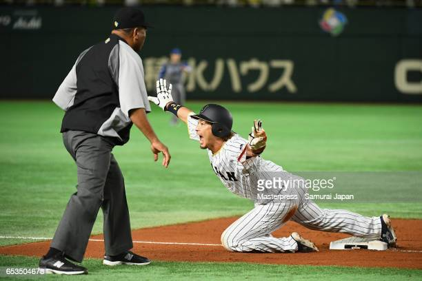 Infielder Nobuhiro Matsuda of Japan reacts after sliding safely on the third base in the bottom of the sixth inning during the World Baseball Classic...