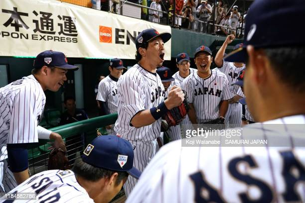Infielder Nobuhiro Matsuda of Japan talks to his team mates in the huddle prior to the game one between Samurai Japan and Canada at the Okinawa...